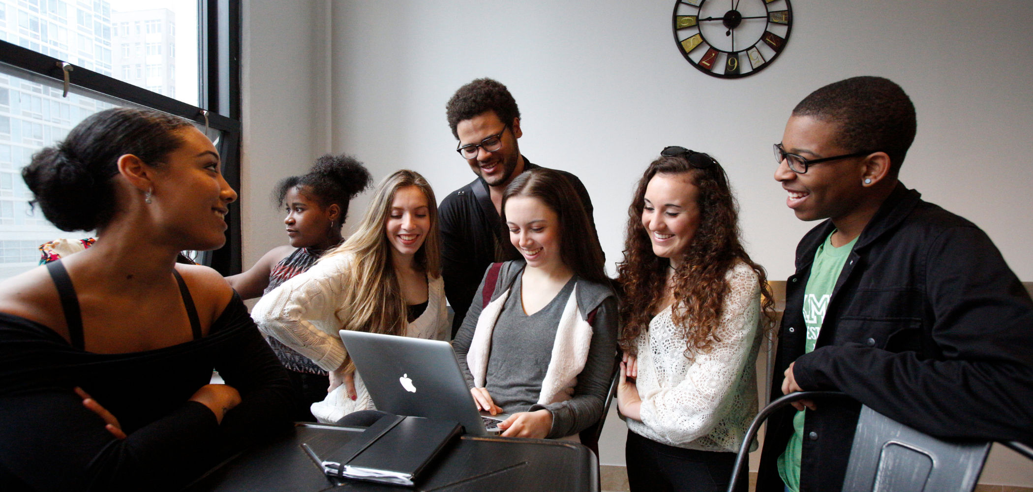 Students gathering around computer