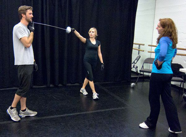 AMDA faculty member Lacy Altwine works with alumni earning their Stage Combat Certification.