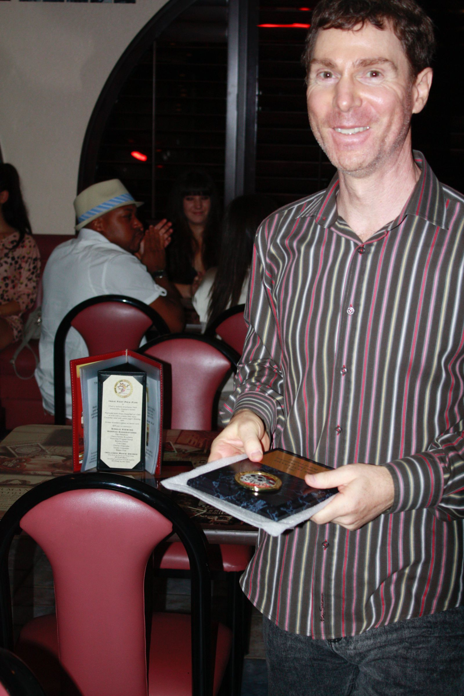 Michael Zelniker holding Indie Fest USA Best of Festival Award